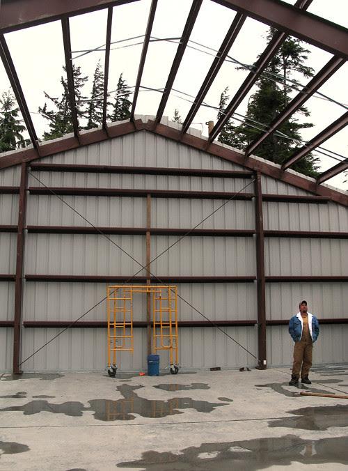 man at construction site of recycling center, Kasaan, Alaska