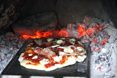 Pizza being baked