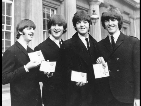 The Beatles smile as they display the Member of The Order of The British Empire medals presented to them by Queen Elizabeth II in a ceremony in Buckingham Palace in London, England on Oct. 26, 1965. Left to right are Ringo Starr, John Lennon, Paul McCartney and George Harrison.