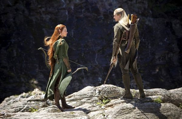 Tauriel (Evangeline Lilly) and Legolas (Orlando Bloom) come to the dwarves' rescue in THE HOBBIT: THE DESOLATION OF SMAUG.