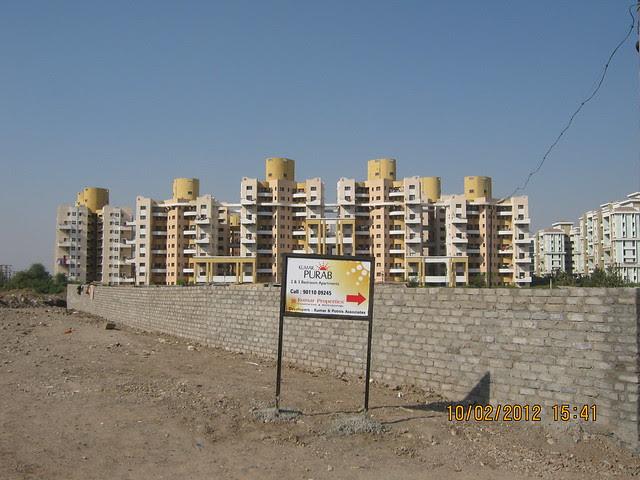 Magarpatta City & compound wall of Kumar Properties' Kumar Purab, 2 BHK & 3 BHK Flats, off Pune Solapur Road, behind Diamond Cars, Hadapsar, Pune 411 028