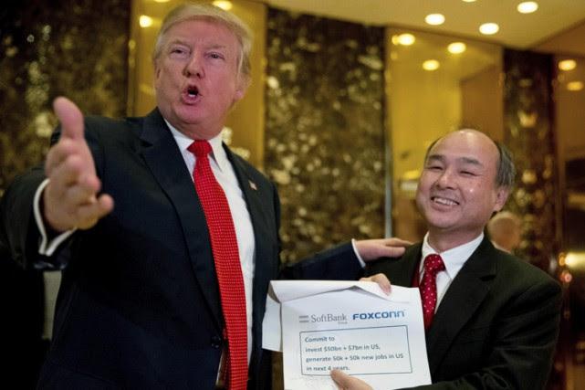 Donald Trump a accueillile PDG de SoftBank, Masayoshi... (PHOTO AP)