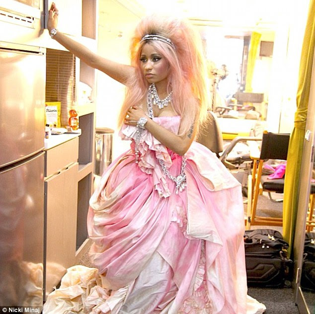 Thinking pink: Nicki clearly stuck to a pink theme for the shoot, wearing a rose-coloured dress with matching highlights in her hair