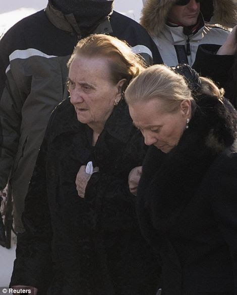 Libertina Manno, left, mother of Vito Rizzuto, head of the infamous crime family, arrives for his funeral in Montreal
