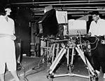 """Ainda enquanto apresentador do """"Jornal da Globo"""", William opera câmera, enquandrando a também âncora Lilian Witte Fibe"""