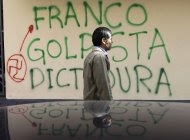 "A man walks in front of wall spray painted with a message that reads in Spanish: ""Franco, Coupist, Dictatorship,"" referring to Paraguay's newly named President Federico Franco, in Asuncion downtown, Paraguay, Tuesday, June 26, 2012. Lugo said Monday that he is aiming to return to power and will rally allies at home and abroad after a landslide congressional vote forced him from office in what he called a break with democracy. Lugo has symbolically created a parallel Cabinet, attacking the legitimacy of the government that replaced him. (AP Photo/Jorge Saenz)"