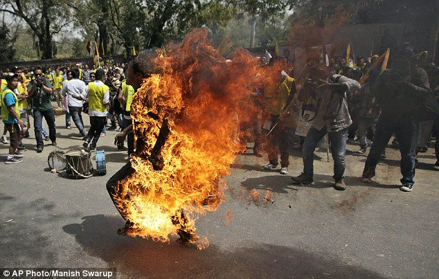 The Tibetan man ran around 50m while on fire in front of the Indian Parliament building in New Delhi, to the shock of onlookers