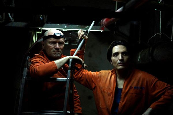 Bud (Michael Rooker) and Lonny (David Dastmalchian) try to find a way to free their fellow employees from the Colombian high-rise building in THE BELKO EXPERIMENT.