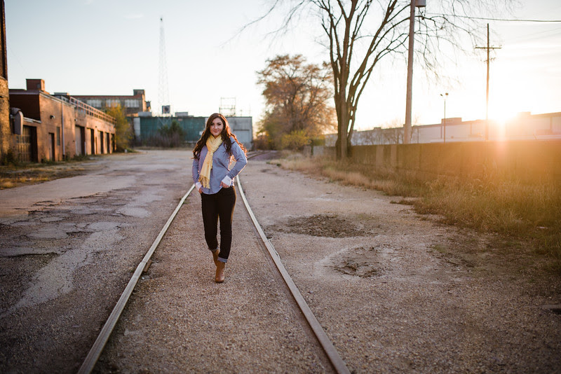 A senior portrait session with Amy. We started a Tinker Swiss Cottage and utilized her bible and the long grasses with the sun setting behind us. She performed many beautful dance moves and poses. Then we changed outfits and went for a more uban chic look in downtown Rockford. We visited some neat brick walls and train tracks. Then we stopped for a coffee and did some night time and evening photos with the cool city lights. Amy and I used a lot of candid and relaxed posing styles for her high school graduation photos.