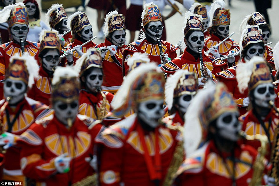 Mexico City's central Zocalo plaza was filled by the papier mache skeletal Catrina figures and candle-covered shrines where people were invited to place photographs of the victims of recent earthquakes