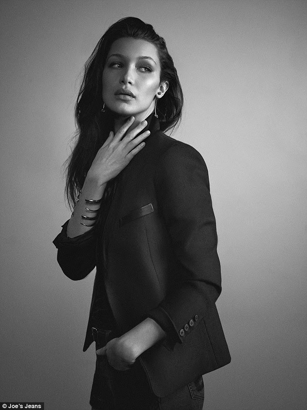 Trademark look: Bella Hadid models distressed cut-off shorts and a structured black blazer in her new Joe's Jean campaign