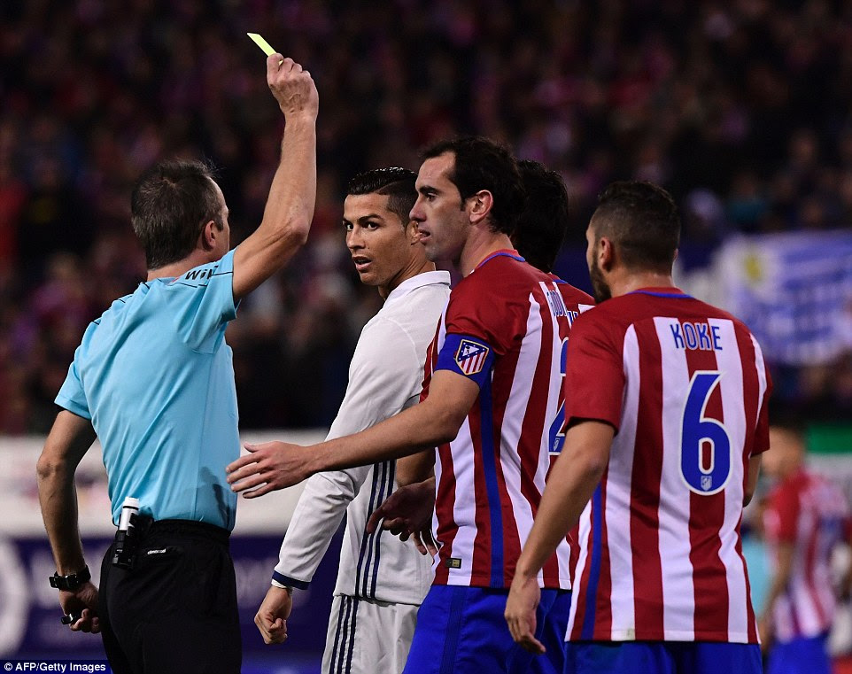 Cristiano Ronaldo and Diego Godin are awarded yellow cards by the referee as tempers flared in the second-half