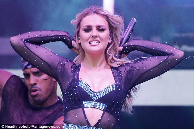 Giving it her all: Perrie's face was full of passion as she performed