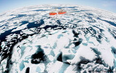 A Canadian Coast Guard icebreaker makes its way through the ice in Baffin Bay. A local researcher says the melt of sea ice surpasses even pessimistic forecasts.