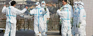 Japan Self Defense Force members prepare to transfer worker exposed to radiation at Fukushima Daiichi nuclear plant (Yomiuri Shimbun/Reuters)