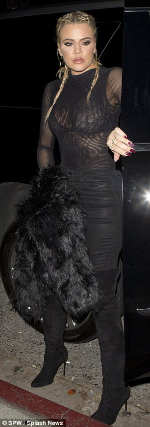 Braided blonde:Khloé dressed her 5ft10in figure in an ultra-sheer top, which showcased her lacy bra