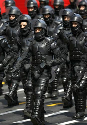 Peruvian anti-riot police officers trying to impersonate Robocop...