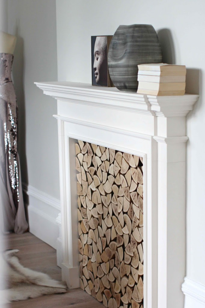 log filled fireplace