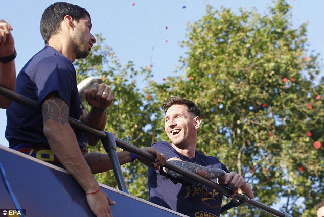 Luis Suarez and Lionel Messi pictured during the celebrations on the bus after they won La Liga