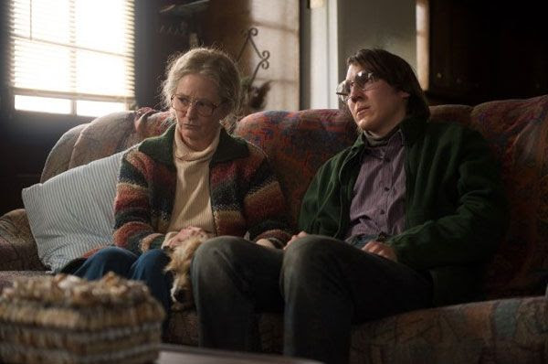 Alex Jones is comforted by his aunt Holly (Melissa Leo) in PRISONERS.
