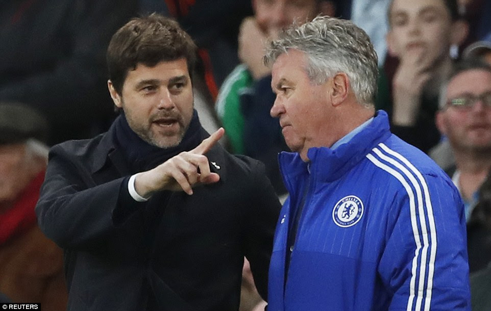 Tottenham boss Pochettino (left) had a word with Chelsea interim manager Guus Hiddink during the early exchanges