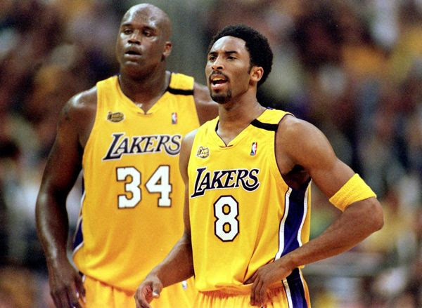 Shaquille O'Neal and Kobe Bryant don Lakers jerseys that were redesigned for the 1999-2000 NBA season...the year that Shaq and Kobe won their first championship.