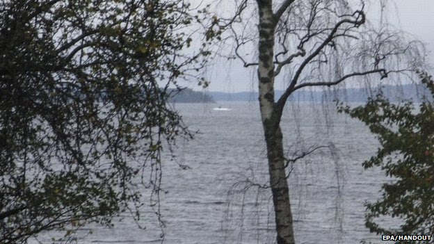 Amateur photo made available on October 19, 2014 by the Swedish Defence Ministry shows an object (top C) in the sea near Stockholm