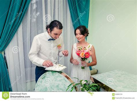 Bride And Groom Exchange Rings At The Wedding Ceremony