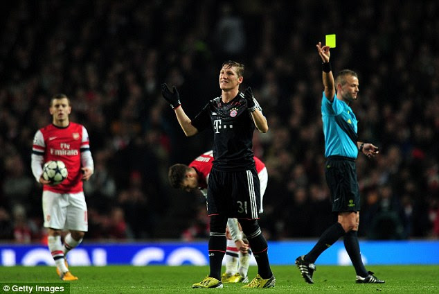 Frustration: Schweinsteiger received a yellow card from ref Svein Oddvar that earned him a one-match ban