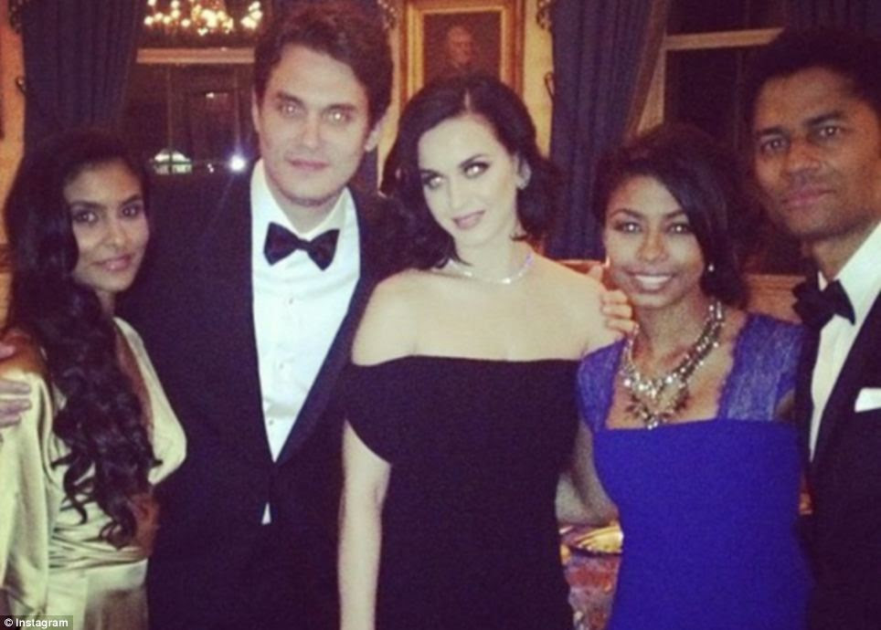 Guest list: India and Eric Benet, right, are pictured with John Mayer and Katy Perry at the White House afterparty. Benet's wife Manuela poses left