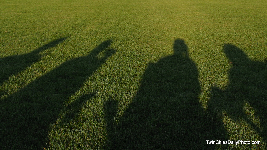 A shadowed self portrait of a local photo blogger