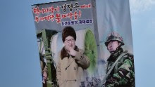 South Korean activists launch large balloons containing anti-Pyongyang leaflets into the air at a field near the Demilitarized zone dividing the two Koreas in Paju on March 26, 2016.