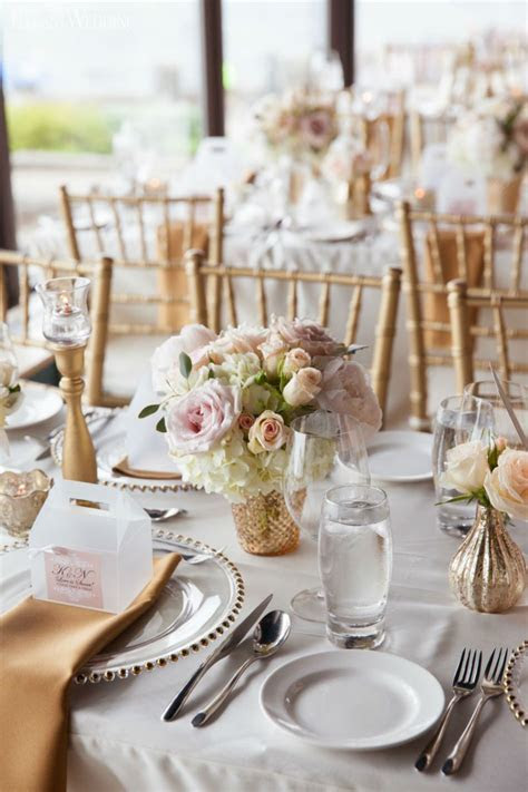 Soft blush pink and gold wedding flowers and decor
