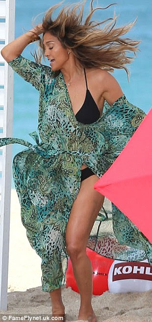 Keeping it under wraps: While J Lo was wearing a little black bikini, she kept her kaftan over the top