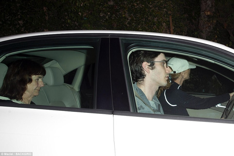 Conrad (pictured driving) and Hefner were together for nine years and had two children - 27-year-old Marston (pictured in the front passenger seat) and Cooper. Pictured in the back seat is believed to be Conrad's mother