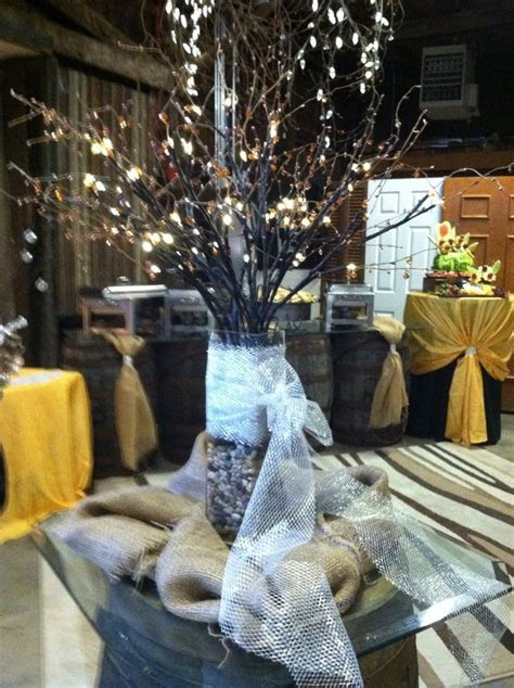 Rustic centerpiece with buffet set up in background. #