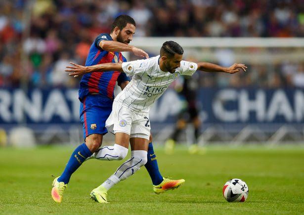 Riyad Mahrez and Arda Turan challenge for the ball