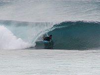 Bodyboarder Lewy Finnegan in a barrel at Oahu North Shore