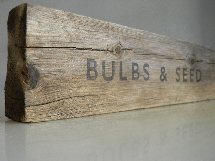 the  Rustic sign old and font, black rustic garden sign, on garden wood.