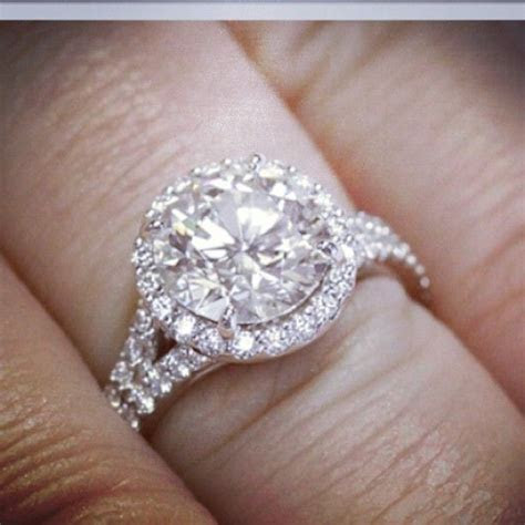 Halo Engagement Ring with round cut center stone, and