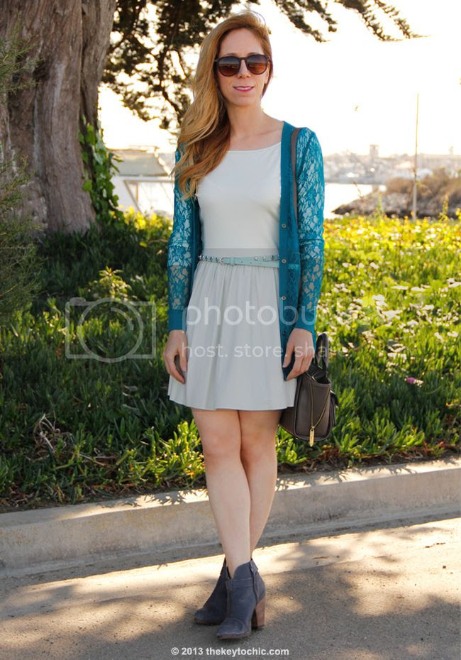 Los Angeles fashion blogger The key To Chic wears a Forever 21 lace cardigan, mint green skater dress,, Phillip Lim for Target satchel, skull belt, and Steve Madden Arieel boots