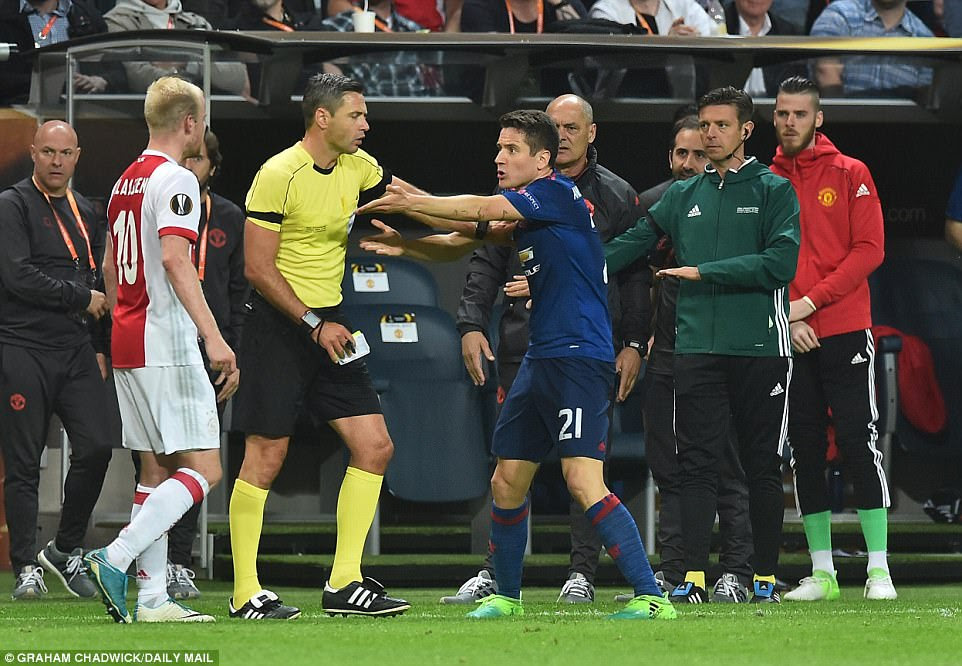 Referee Damir Skomina steps in to separate Klaassen and Herrera and dispel tensions in the latter stages