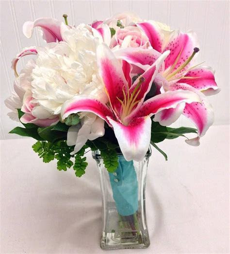 Bridal Bouquet of Stargazer lilies, and white peonies