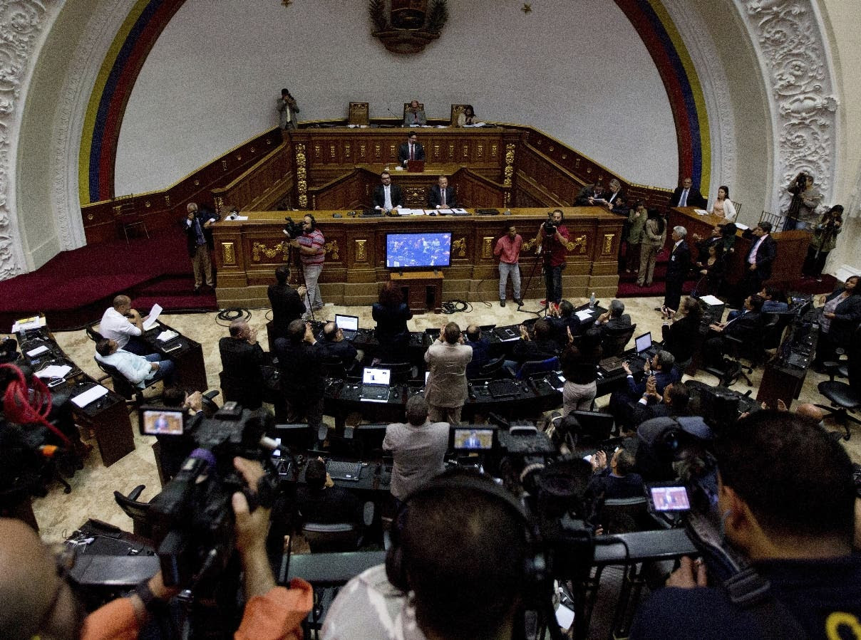 Opposition lawmakers applaud during a session at the National Assembly in Caracas, Venezuela, Monday, Jan. 9, 2017. The clock ran out Monday on the opposition's effort to oust President Nicolas Maduro in a recall vote and Tuesday marks the start of the last two years of Maduro's term. (AP Photo/Fernando Llano)