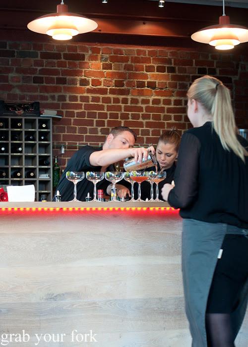 Pouring cocktails at Restaurant Dansk for A Danish Food Trail