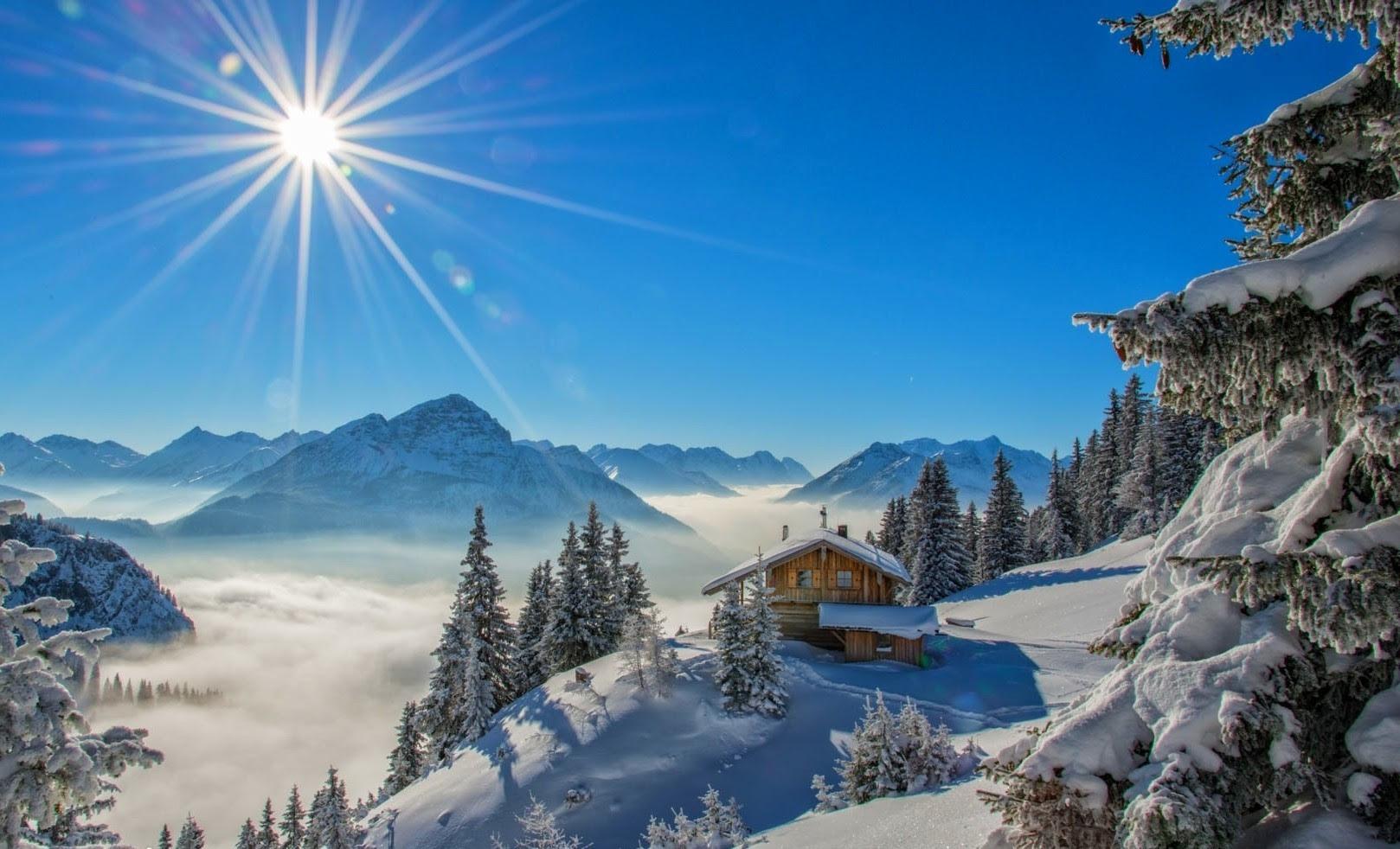 winter sun rays cottage snow mountain forest snowy peak blue