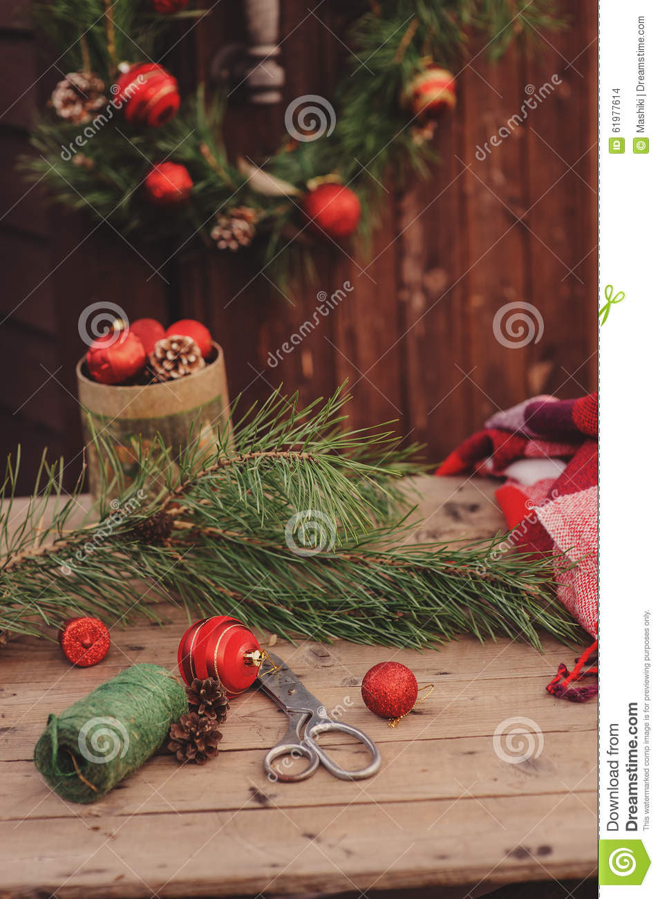 Christmas decorations at cozy wooden country house, outdoor setting on