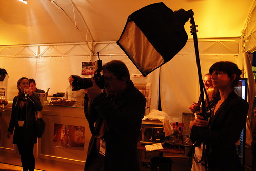 Photographer with assistant holding a light