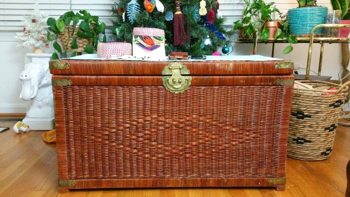 ornate brass details wicker trunk boho