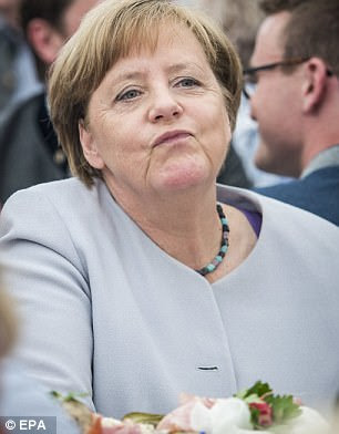 German Chancellor Angela Merkel attends an election campaign event on Sunday, May 28